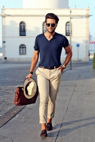 A henley shirt and nude chinos feel perfectly suited for weekend activities of all kinds. Go for a pair of dark brown suede tassel loafers for a masculine aesthetic.