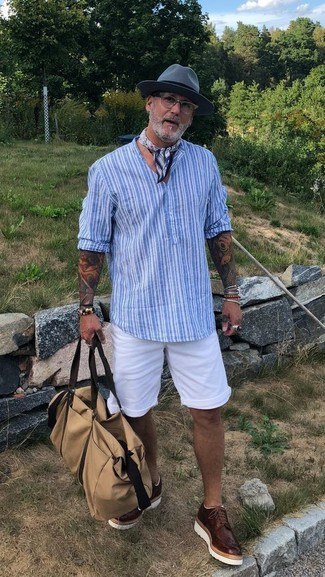 How to wear: light blue vertical striped henley shirt, white shorts, dark brown leather brogues, beige canvas holdall