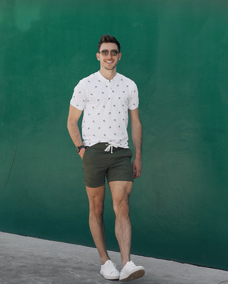 How to wear: white print henley shirt, olive shorts, white leather low top sneakers, brown sunglasses
