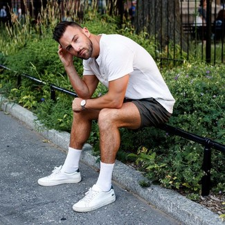 How to wear: white henley shirt, black shorts, white leather low top sneakers, grey leather watch