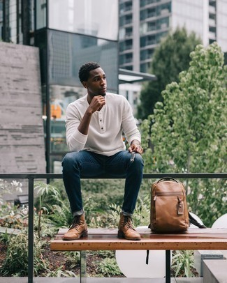 Henley Sweater Outfits: Wear a henley sweater and navy jeans if you seek to look casual and cool without much effort. Ramp up your getup by finishing with a pair of tan leather casual boots.