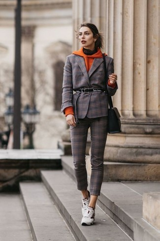 If you want to look cool and remain cosy, try teaming an orange hoodie with a black leather crossbody bag. Opt for a pair of white athletic shoes to have some fun with things. Keep this combination ready to go when spring sets it, and we promise you'll save a lot of time brainstorming for an ensemble on more than one occasion.