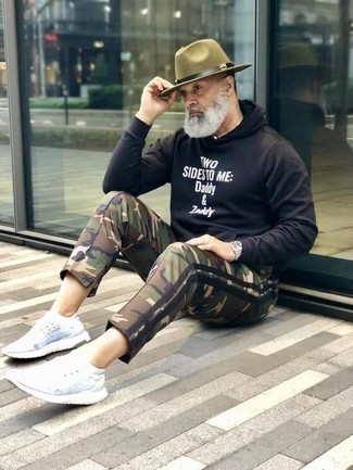 How to Wear Camouflage Pants For Men: This combo of a black and white print hoodie and camouflage pants looks awesome and makes you look instantly cooler. Put a different spin on this look by rocking a pair of white athletic shoes.