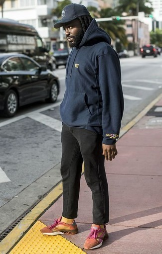 How to Wear a Navy Hoodie Casually For Men: A navy hoodie and black chinos are a smart combo to have in your day-to-day casual wardrobe. Orange athletic shoes are guaranteed to bring a dose of stylish nonchalance to your outfit.