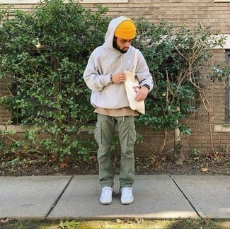 Beanie Outfits For Men: A white hoodie and a beanie are veritable essentials if you're putting together a casual closet that holds to the highest fashion standards. Wondering how to complete your outfit? Round off with white canvas low top sneakers to smarten it up.