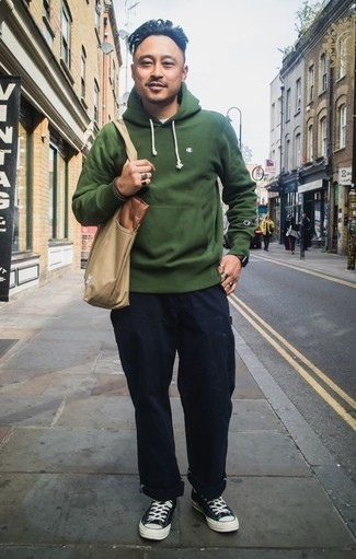 How to Wear a Dark Green Hoodie For Men: A perfectly put together combination of a dark green hoodie and navy chinos will set you apart instantly. A pair of black and white canvas low top sneakers is a surefire footwear option here that's also full of personality.
