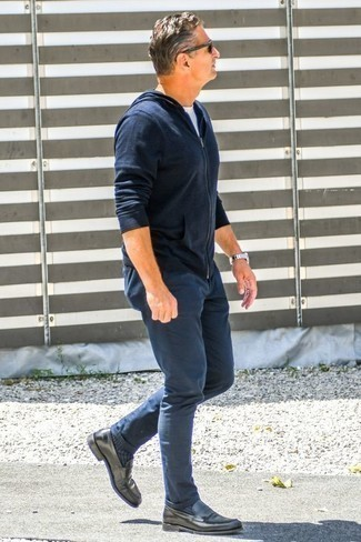 How to Wear a Navy Hoodie For Men: The versatility of a navy hoodie and navy chinos ensures you'll always have them on heavy rotation. Serve a little outfit-mixing magic by finishing with a pair of charcoal leather loafers.