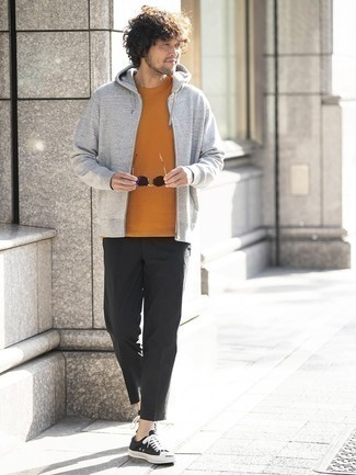 Grey Hoodie Outfits For Men: Consider pairing a grey hoodie with black chinos to show you've got expert sartorial prowess. Let your sartorial savvy really shine by finishing off this getup with a pair of black and white canvas low top sneakers.