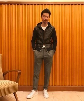 White Leather Low Top Sneakers Outfits For Men: This casual combination of a black leather hoodie and grey chinos is a winning option when you need to look sharp but have no time to dress up. A pair of white leather low top sneakers acts as the glue that will bring this look together.