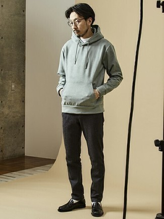 Grey Hoodie Smart Casual Outfits For Men: This laid-back pairing of a grey hoodie and charcoal chinos is a safe option when you need to look dapper in a flash. For a classier finish, complement your ensemble with a pair of black leather loafers.