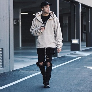 How to wear: beige fleece hoodie, black and white print crew-neck t-shirt, black ripped jeans, black athletic shoes