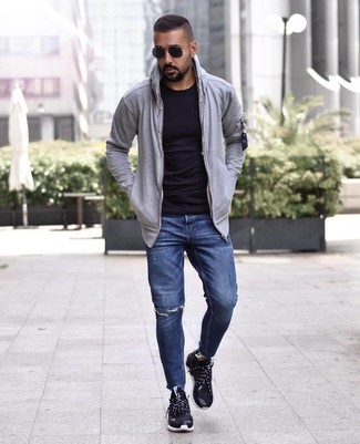 How to wear: grey hoodie, black crew-neck t-shirt, navy ripped jeans, black athletic shoes