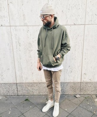 How to Wear White Leather High Top Sneakers For Men: Opt for an olive hoodie and khaki jeans for a sharp, casual look. Unimpressed with this outfit? Enter a pair of white leather high top sneakers to mix things up.