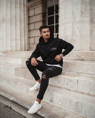 Black Jeans with Black Hoodie Spring Outfits For Men: This contemporary combination of a black hoodie and black jeans can take on different forms according to the way you style it out. As for footwear, complete this look with a pair of white canvas low top sneakers. A great example of transeasonal fashion, this outfit is perfect come warmer days.