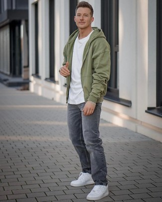 Grey Jeans Outfits For Men: Why not pair an olive hoodie with grey jeans? These two items are very practical and will look great when married together. All you need now is a pair of white leather low top sneakers to complete this ensemble.