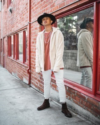White Jeans Outfits For Men: This relaxed pairing of a white fleece hoodie and white jeans is very easy to put together in seconds time, helping you look dapper and prepared for anything without spending too much time rummaging through your wardrobe. Want to break out of the mold? Then why not add a pair of dark brown suede chelsea boots to the mix?