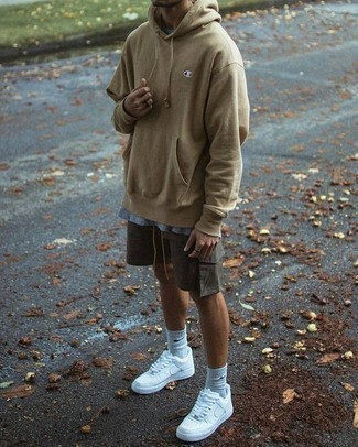 Men's Looks & Outfits: What To Wear In a Relaxed Way: A tan hoodie and charcoal shorts are definitely worth being on your list of menswear staples. Does this getup feel too polished? Enter white athletic shoes to spice things up.