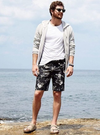 Grey Hoodie Summer Outfits For Men: Dress in a grey hoodie and black floral shorts for a casual outfit with a twist. For a more laid-back touch, complete this ensemble with beige suede sandals. A knockout getup like this one is just what you need come hot summer days.