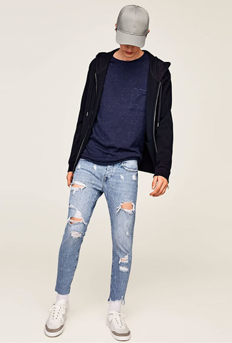 How to wear: black hoodie, navy crew-neck t-shirt, light blue ripped skinny jeans, white low top sneakers