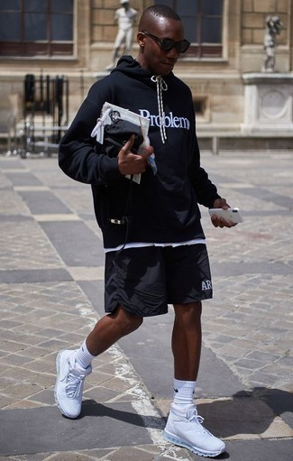 How to Wear a Black and White Print Hoodie For Men: We're all scouting for comfort when it comes to styling, and this city casual combo of a black and white print hoodie and black sports shorts is an amazing example of that. A pair of white athletic shoes makes your ensemble whole.