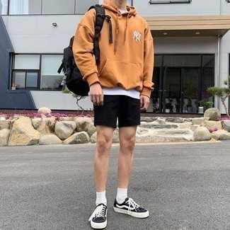 Black Sports Shorts Outfits For Men: For comfort dressing with an edgy take, you can rely on a tobacco hoodie and black sports shorts. Play up the classiness of this look a bit by slipping into black and white canvas low top sneakers.