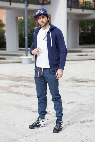 How to wear: navy hoodie, white and black print crew-neck t-shirt, navy sweatpants, black leather high top sneakers