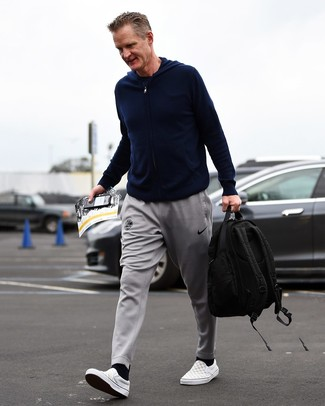 How to wear: navy hoodie, navy crew-neck t-shirt, grey sweatpants, grey check canvas slip-on sneakers