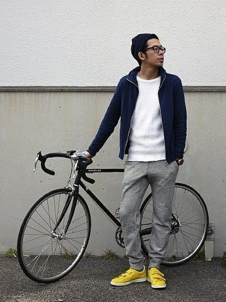 How to Wear a Navy Hoodie For Men: For something more on the casual and cool end, wear a navy hoodie and grey sweatpants. And if you want to immediately bump up this look with one piece, why not slip into yellow canvas low top sneakers?