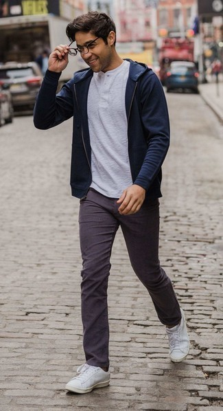 Henley Shirt Outfits For Men: This pairing of a henley shirt and violet jeans is super easy to pull together and so comfortable to wear a variation of all day long as well! The whole look comes together really well if you introduce white leather low top sneakers to your look.