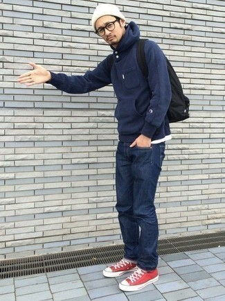 How to Wear a Navy Hoodie Casually For Men: Consider teaming a navy hoodie with navy jeans to pull together an everyday outfit that's full of charisma and character. A pair of red canvas low top sneakers can integrate brilliantly within a variety of outfits.