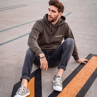 Tobacco Print Hoodie Outfits For Men: This street style combination of a tobacco print hoodie and charcoal jeans is super easy to pull together without a second thought, helping you look seriously stylish and ready for anything without spending a ton of time searching through your wardrobe. Complete this ensemble with a pair of tan canvas low top sneakers and ta-da: the look is complete.