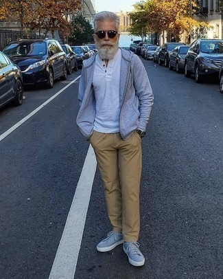 Grey Hoodie Outfits For Men After 50: If you like casual style, why not wear a grey hoodie with khaki chinos? Grey canvas low top sneakers look amazing finishing your getup. Those who are curious whether you can still sport edgy casual looks as you step into your 50s, this outfit should answer your question.