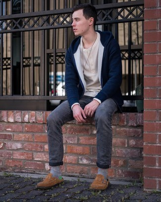 Beige Long Sleeve Henley Shirt Outfits For Men: This relaxed casual pairing of a beige long sleeve henley shirt and charcoal jeans is super easy to pull together in no time flat, helping you look dapper and ready for anything without spending a ton of time rummaging through your closet. And if you wish to effortlessly up the ante of this look with footwear, complement this outfit with a pair of brown suede loafers.