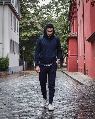 How to Wear a Navy Hoodie For Men: A navy hoodie and navy chinos are the perfect way to introduce effortless cool into your casual styling collection. Introduce a pair of white canvas low top sneakers to your look to tie your full look together.