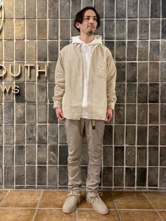 Khaki Chinos Spring Outfits: For a casual getup, reach for a white hoodie and khaki chinos — these two items work really well together. You can get a bit experimental in the footwear department and complete this outfit with a pair of beige suede desert boots. With springtime in the air, it's time to sport simple and seriously stylish outfits, just like this one.