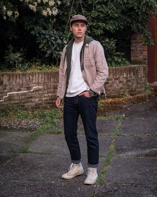 Beige Canvas High Top Sneakers Outfits For Men: Try pairing a dark green hoodie with navy jeans for an everyday outfit that's full of charisma and character. Finishing off with a pair of beige canvas high top sneakers is a surefire way to infuse a sense of stylish nonchalance into this ensemble.