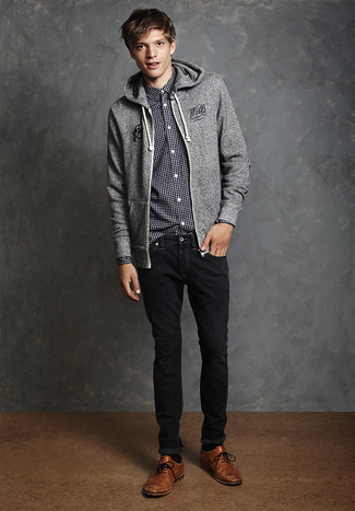 How to wear: grey hoodie, black and white gingham long sleeve shirt, black jeans, brown leather brogues