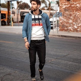 Blue Chambray Long Sleeve Shirt Outfits For Men: A blue chambray long sleeve shirt and black ripped jeans are among the fundamental elements in any man's great off-duty closet. For something more on the casually edgy side to finish this outfit, introduce charcoal athletic shoes to your look.