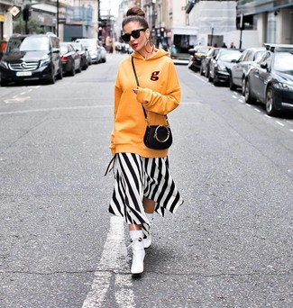 How to Wear White and Black Dress: White and black dress and an orange hoodie are a nice outfit formula to add to your arsenal. To add some extra depth to this look, add white leather ankle boots to the equation.
