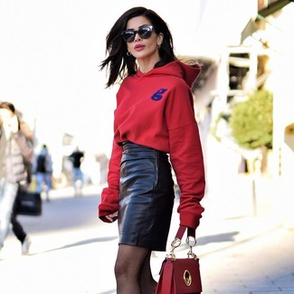 Red Hoodie Outfits For Women: Irrefutable proof that a red hoodie and a black leather mini skirt are awesome when paired together in a laid-back look.
