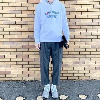 Grey Athletic Shoes Outfits For Men: Putting together a white print hoodie with charcoal wool chinos is a wonderful idea for a casually dapper look. Complement this ensemble with grey athletic shoes to infuse a sense of stylish effortlessness into your look.