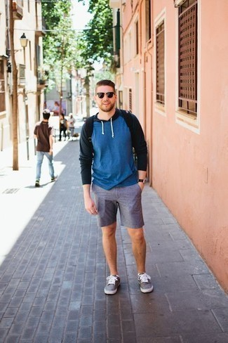 Men's Looks & Outfits: What To Wear In 2020: When the setting permits a relaxed outfit, wear a blue hoodie and blue shorts. A pair of grey canvas low top sneakers can integrate effortlessly within a myriad of looks.