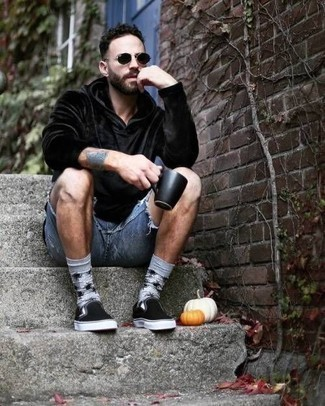 Blue Denim Shorts Outfits For Men: A black velvet hoodie and blue denim shorts are a good combination worth incorporating into your current casual collection. Finish with a pair of black canvas slip-on sneakers to power up your look.