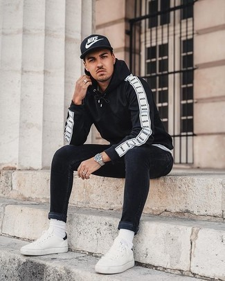 Socks Outfits For Men: For relaxed dressing with an edgy take, consider teaming a black and white hoodie with socks. Not sure how to finish off your look? Rock a pair of white and black canvas low top sneakers to rev up the style factor.