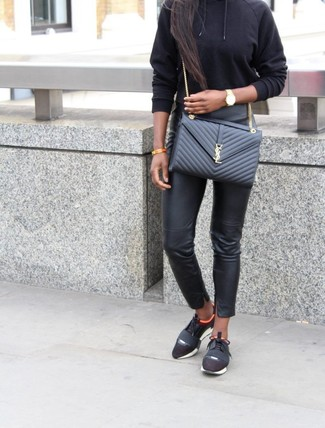 How to wear: black hoodie, black leather skinny pants, black athletic shoes, black quilted leather crossbody bag