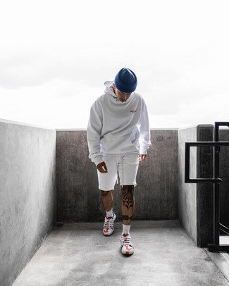 White Sports Shorts Outfits For Men: This combo of a white hoodie and white sports shorts is a safe and very fashionable bet. Complement this outfit with a pair of white and red and navy athletic shoes for maximum fashion points.