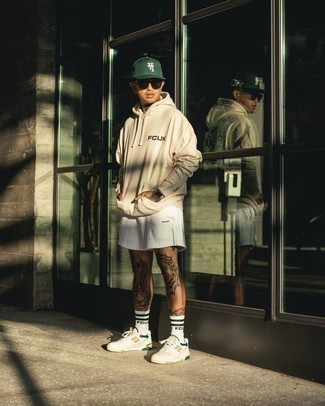 White Sports Shorts Outfits For Men: Something as simple as opting for a beige print hoodie and white sports shorts can actually help you stand out. Get a little creative on the shoe front and introduce white print leather low top sneakers to the equation.