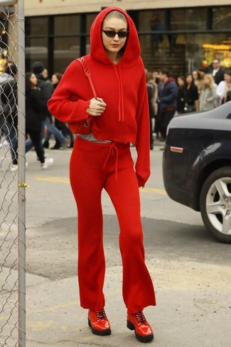 How to Wear a Red Hoodie For Women: Show your sartorial skills by combining a red hoodie and red sweatpants for a laid-back look. Complement your getup with a pair of red leather derby shoes to spice things up.