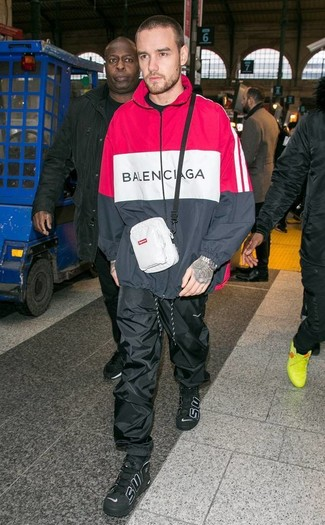 How to wear: red and black hoodie, black sweatpants, black leather high top sneakers, white fanny pack