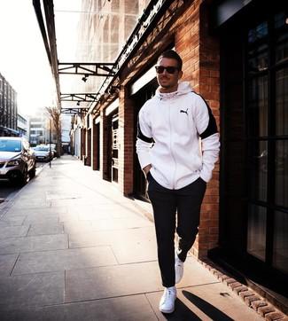 How to wear: white and black hoodie, black sweatpants, white low top sneakers, dark brown sunglasses